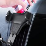 Оригинал ABSАвтоДержательдлятелефонаДержатель для установки воздуховода для гравитационного крепления для iPhone / Samsung / Xiaomi